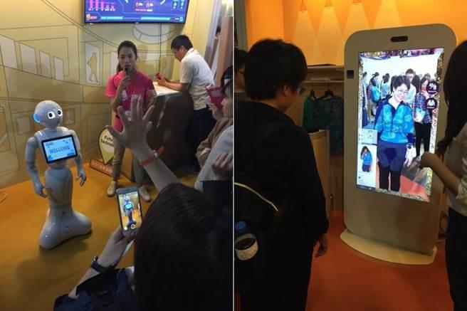 有廠商在未來商務展中展出虛擬試衣間,還可以與Pepper機器人面對面,民眾興奮體驗。(圖/黃慧雯攝)