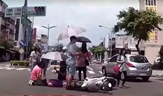 男違規左轉被撞昏迷倒地 民眾熱心撐傘遮陽