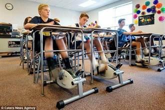 課桌下裝自行車踏板 學生踩出好成績