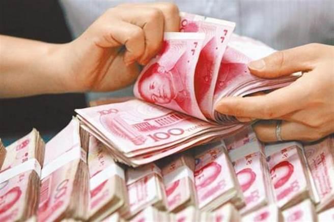 擔心資本外流加劇,中國大砍外企可匯出資金上限。(美聯社資料照)