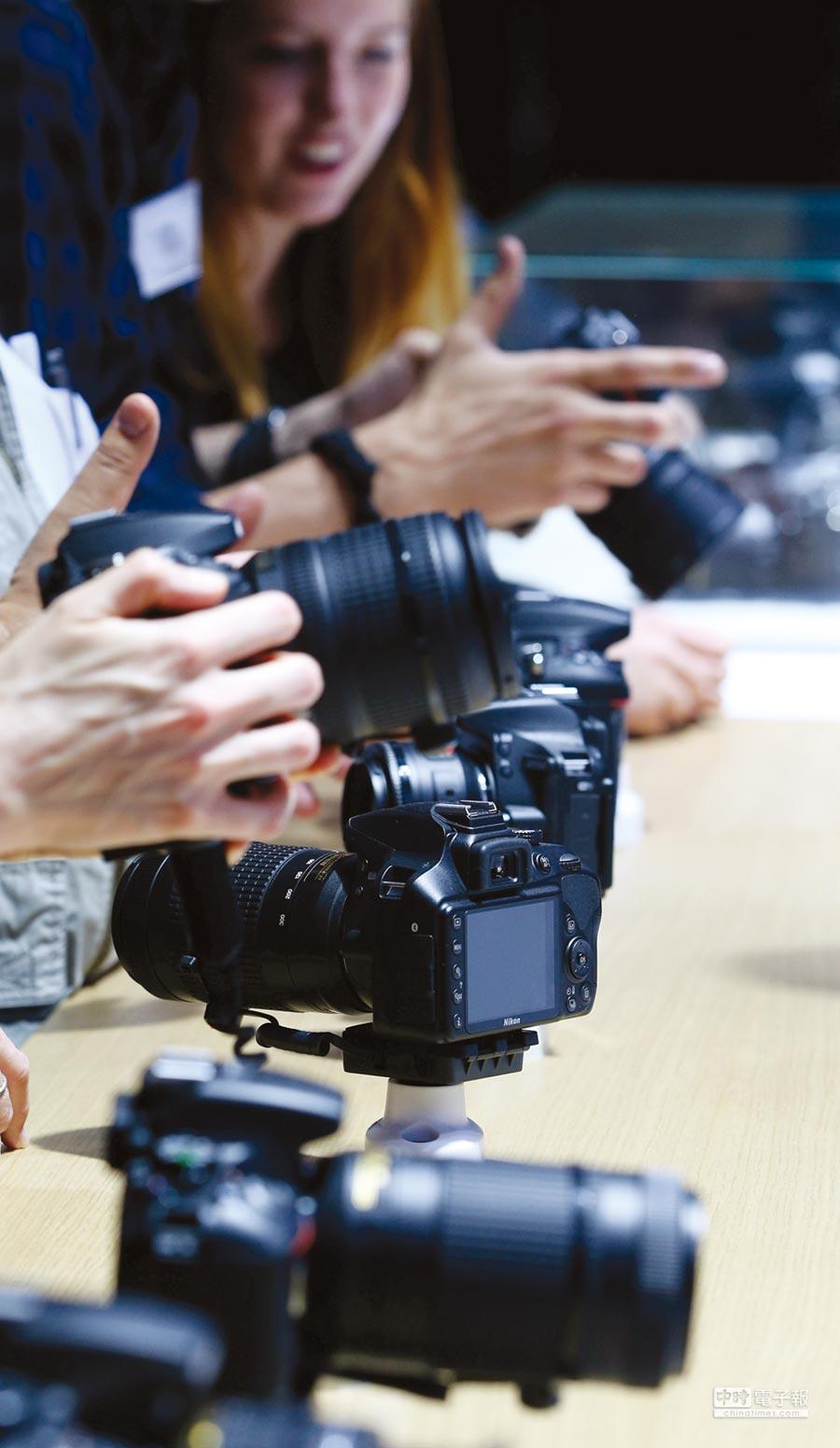 數位相機群族本季表現報佳音。圖/路透