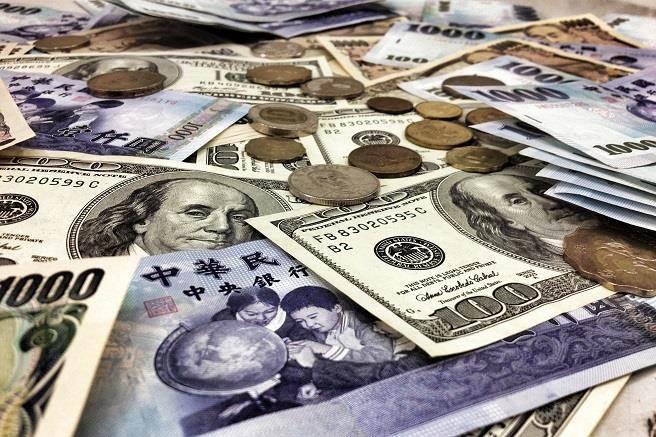 美國聯準會宣布升息一碼,美元看升,亞幣恐爆發競貶潮。(資料照/鄧博仁攝)