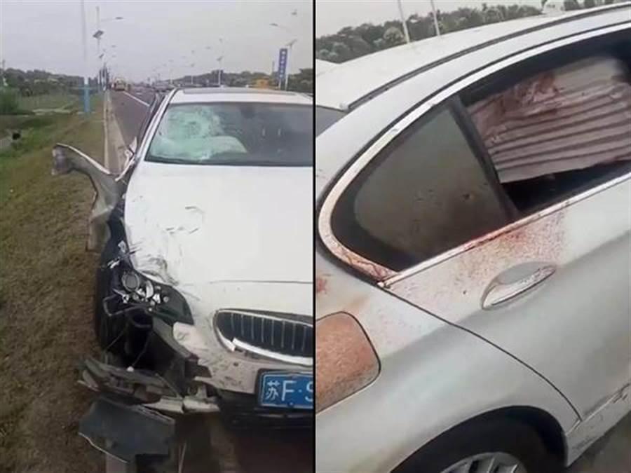BMW將騎士撞到「分屍」,車體沾滿血漬。(圖/翻攝微信)