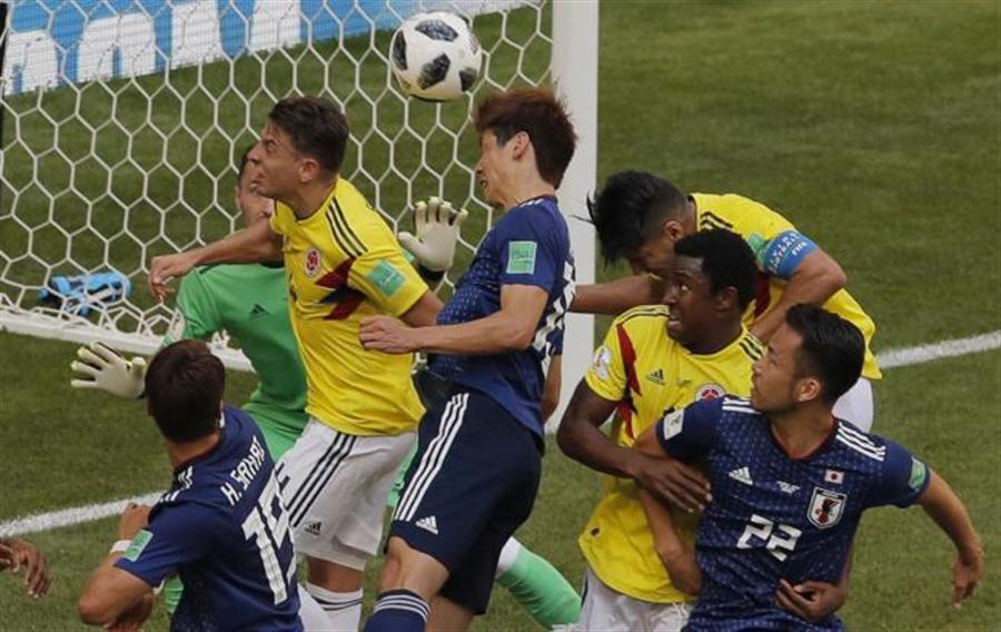 日本在小組賽靠一張紅牌打敗哥倫比亞。(資料照/美聯社)