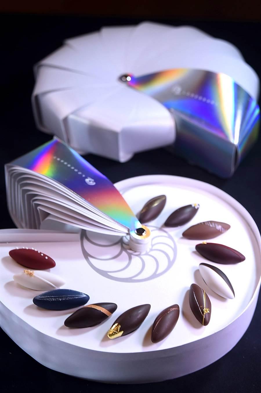 〈L.Z.DESSART〉的魚形巧克力禮盒,是陳立喆以鸚鵡螺造形發想設計,珍珠白的盒身並有七彩雷射炫光,優雅與時尚兼具。(攝影/姚舜)