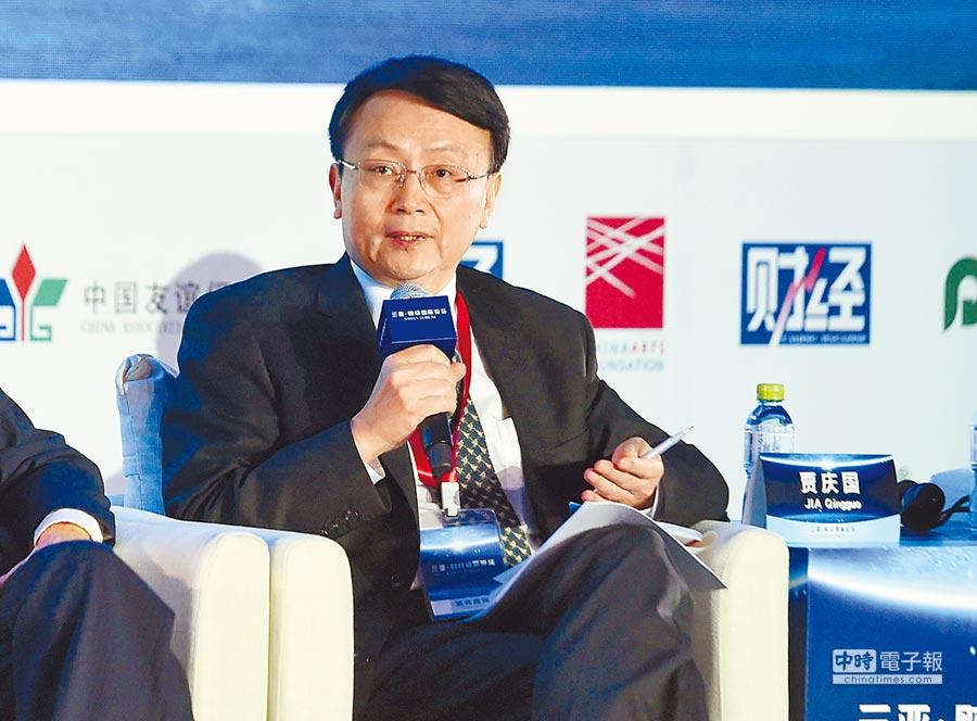 大陸全國政協常委、北京大學國際關係學院院長賈慶國表示,面對貿易摩擦必須加快改革開放步伐。(新華社)