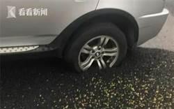 違停寶馬慘遭柏油「活埋」網:趕緊回來救救你的車