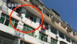 女孩爬窗輕生 遭消防員精準「噴射」回屋
