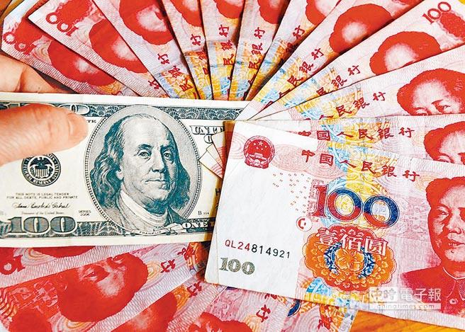 人民幣及美元。(新華社資料照片)