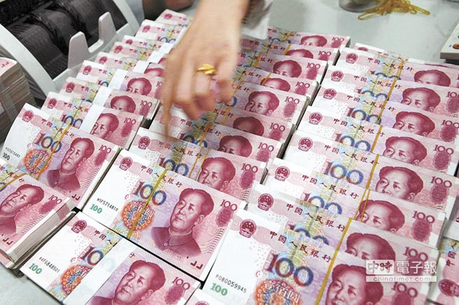 人行稱,這次降準不會造成人民幣貶值壓力。(新華社資料照片)