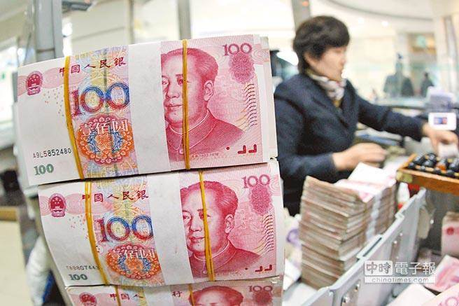 儘管人民幣近期貶不休,但專家認為,人民幣不太可能跌破7的心理關卡。(中新社)