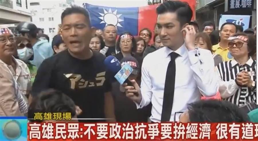 黑衣男子也站出來說自己外漂,並說韓國瑜說高雄拼經濟,台北拼政治有什麼錯。(中時電子報直播)