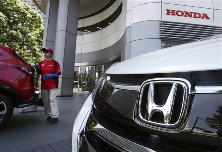 美中貿易戰延燒,導致日本車廠獲利受重創。(美聯社)