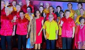 APEC經濟領袖全家福 張忠謀選巴紐黃色襯衫