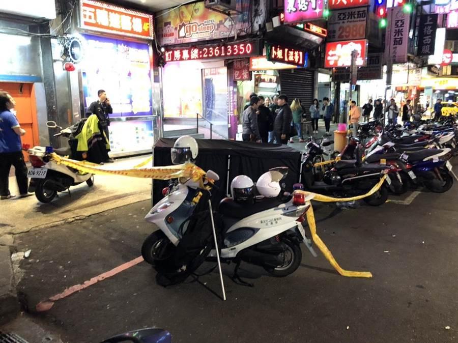 北市漢口街二段13日晚上7點多發生一名趙姓女子墜樓自殺案。〔謝明俊翻攝〕