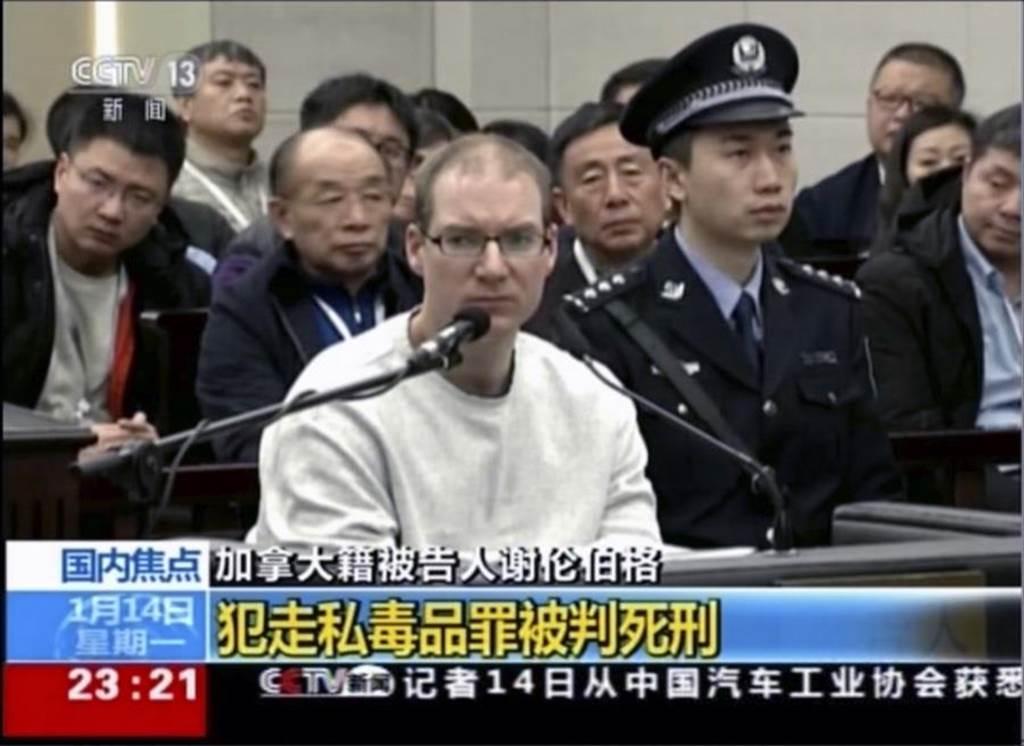 加拿大男子谢伦伯格14日出庭画面。(图/美联社、央视)(photo:ChinaTimes)