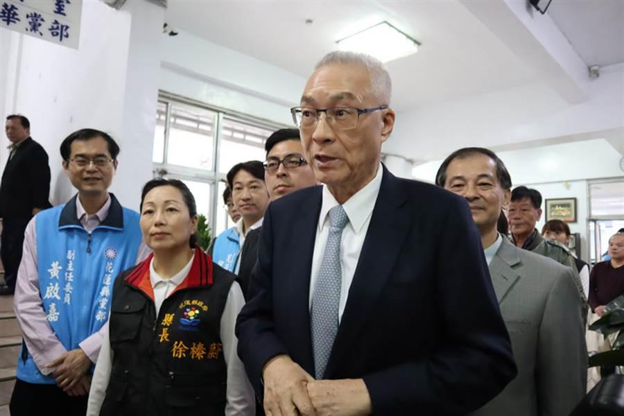 國民黨主席吳敦義(前右)。(圖片來源:中央社)