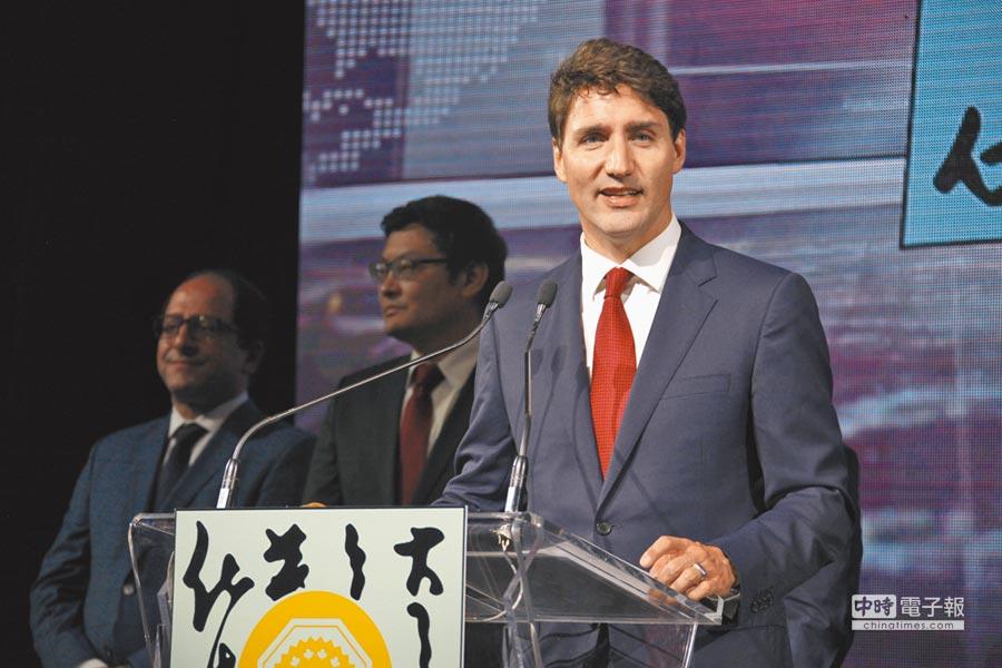 加拿大總理杜魯道將在首都渥太華接見甫奪得NBA總冠軍的暴龍全隊,狠狠打了川普一巴掌。(中新社資料照)