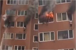 女穿內衣懸掛8樓外牆躲大火 博命4分鐘獲救