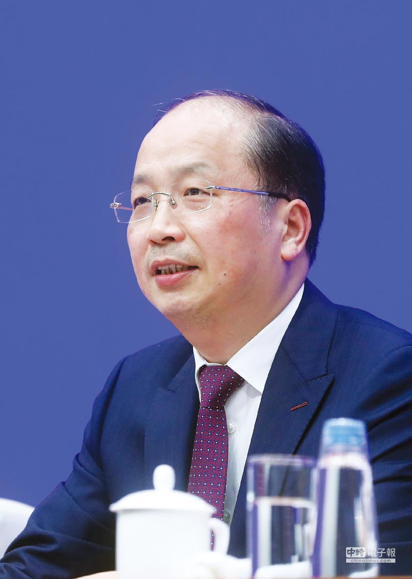 中國證監會主席易會滿表示,欺詐上市的最高刑期將在人大修法中討論。圖/中新社