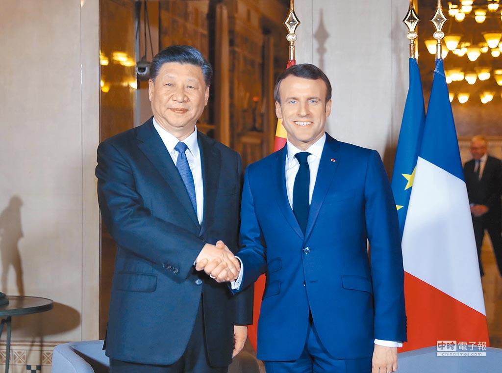大陸國家主席習近平(左)會見法國總統馬克宏。(新華社資料照片)