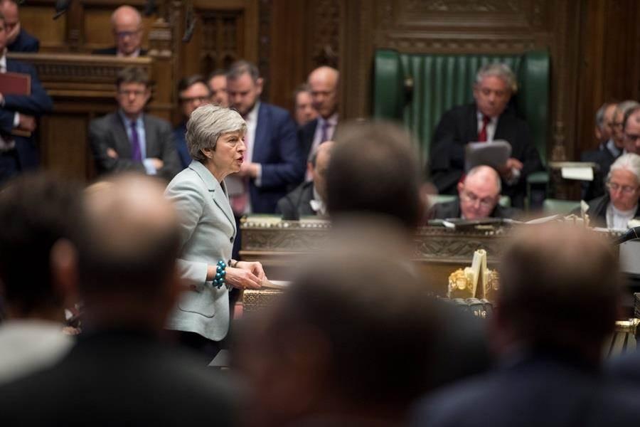 英國首相梅伊再度遭逢恥辱性挫敗,國會25日晚間以27票之差奪下脫歐進程主導權。(圖/路透社)