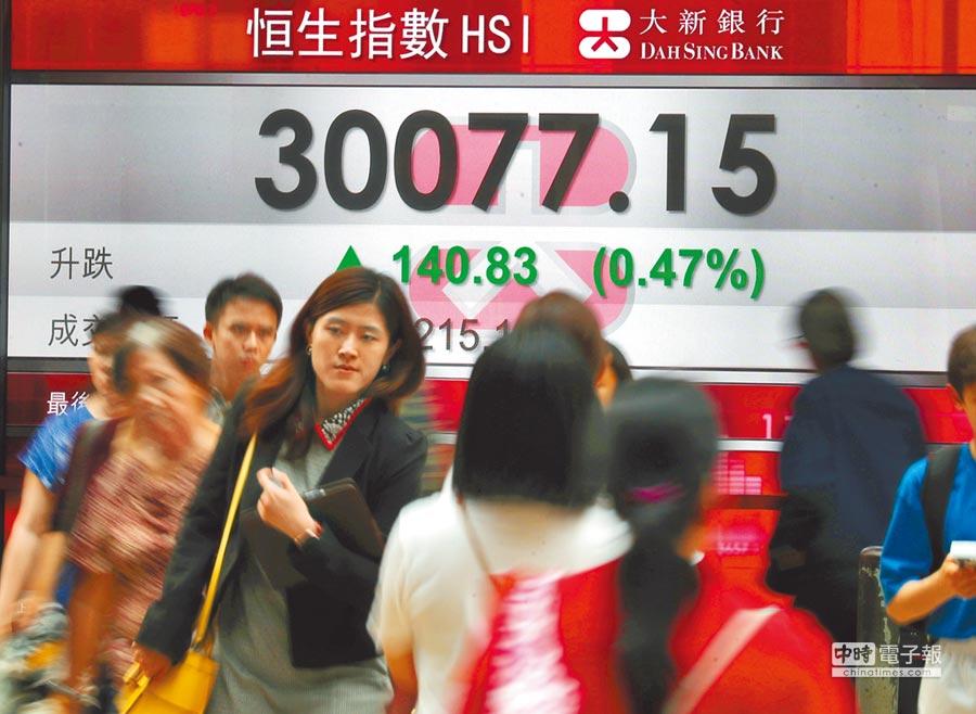 亞股股息支付相對豐厚,在市場震盪之際相對有能力提供正報酬。(新華社)