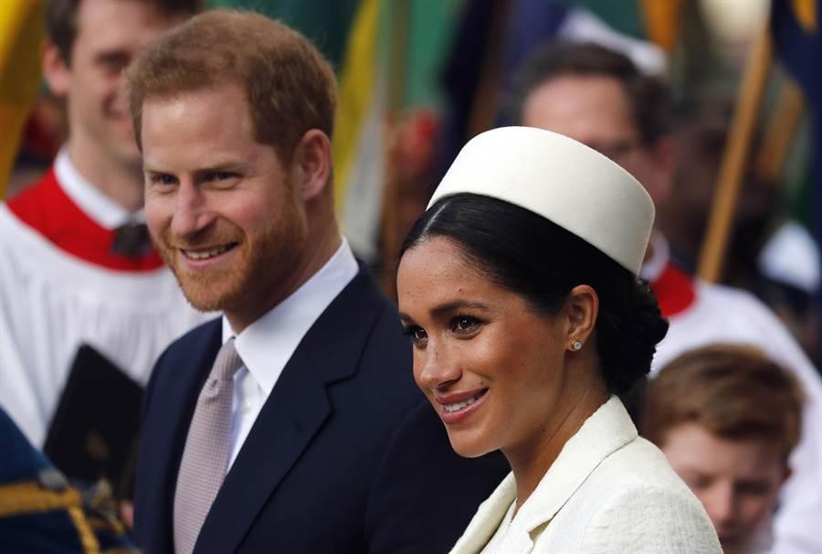 梅根和夫婿哈利王子3月11日在倫敦的資料照。(美聯社)