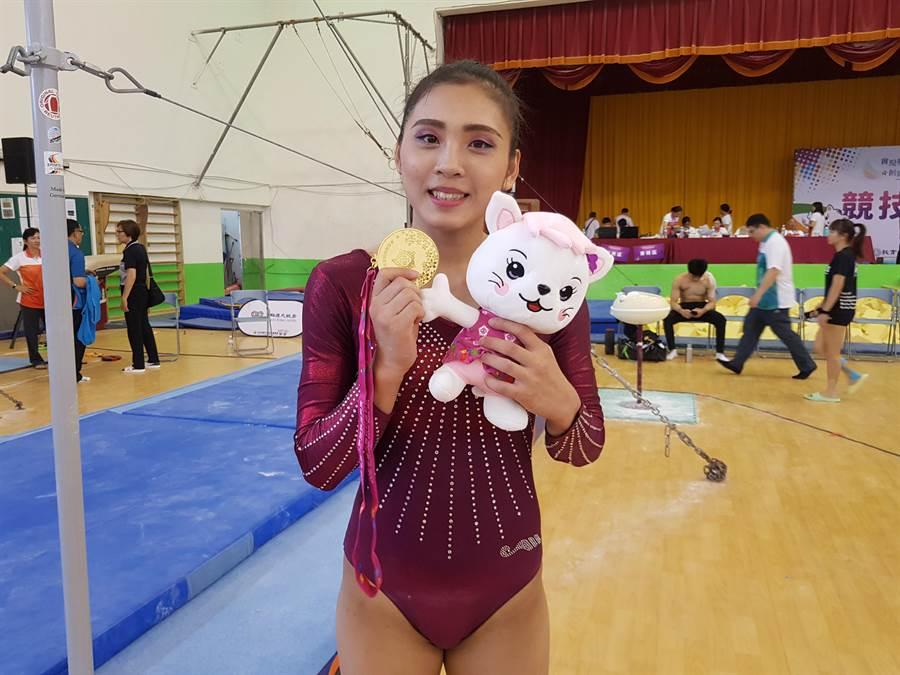 台灣師大體操女將麥劉湘涵,今天在個人全能摘金,從2011年參加全大運以來,個人累積已有28金。(陳筱琳攝)