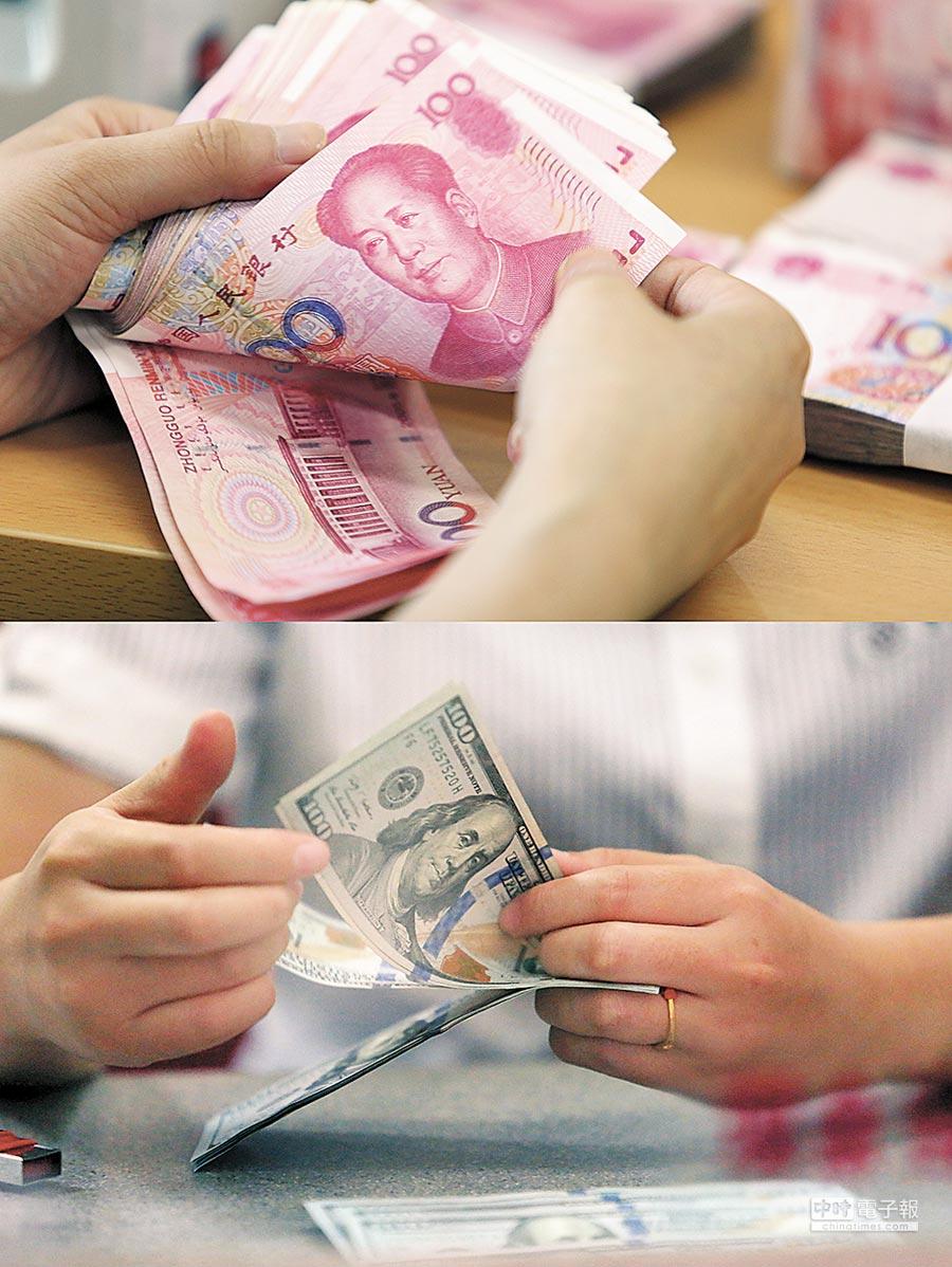 5月4日,離岸人民幣上漲118點。圖為銀行員清點人民幣與美元。(新華社資料照片)