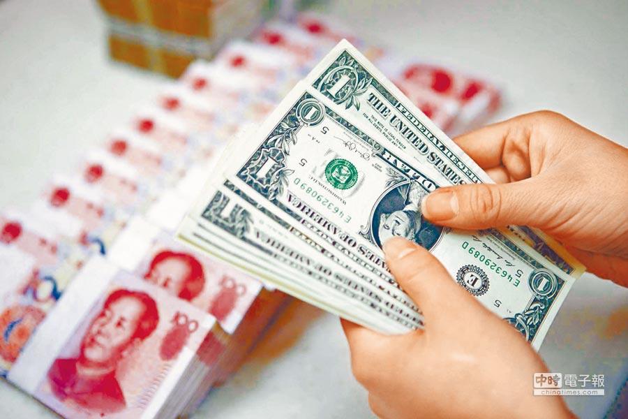 年底前人民幣兌美元匯率有望回到6.5價位。(中新社)
