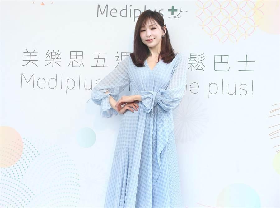 王心凌今以一襲水藍色洋裝,出席保養品代言活動。(粘耿豪攝)