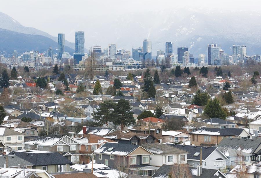 加拿大政府指出,非法資金對溫哥華房市的影響力不斷增加。圖/路透