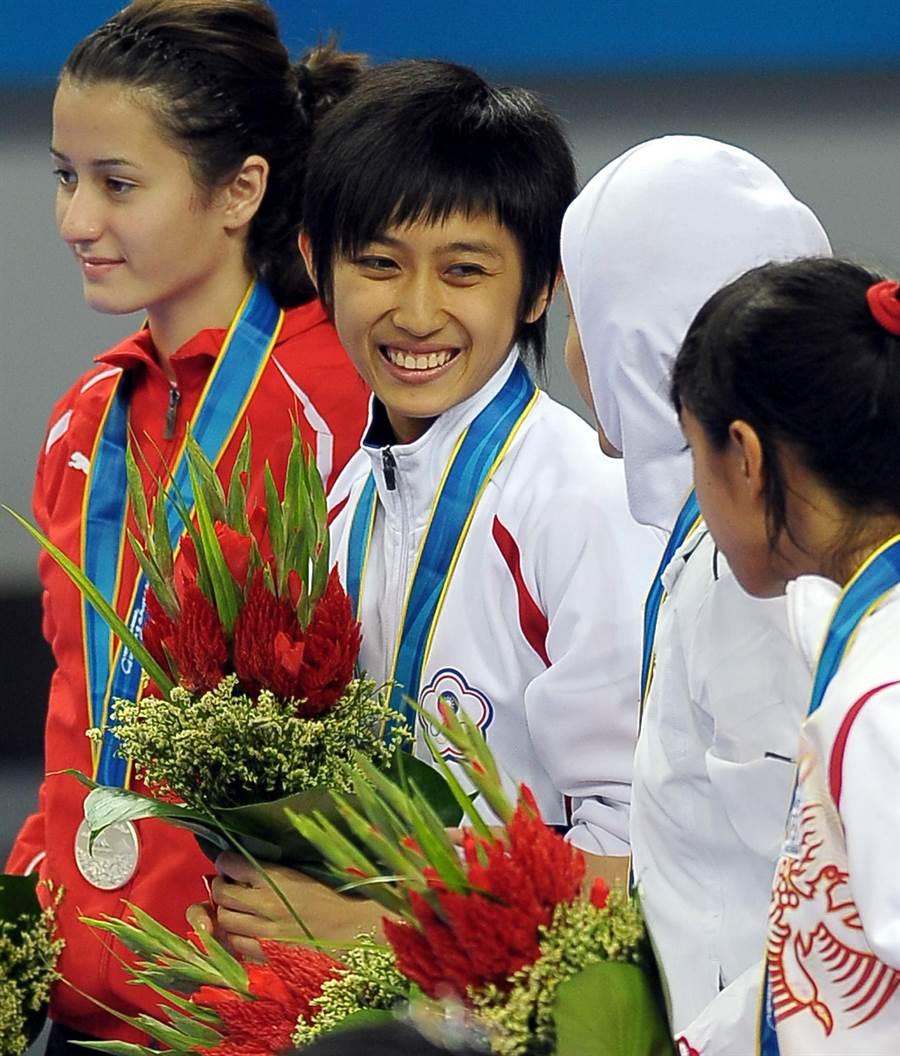 黃顯詠(左二)是2010廣州亞運女子46公斤級跆拳道金牌。(中時資料照 季志翔攝)