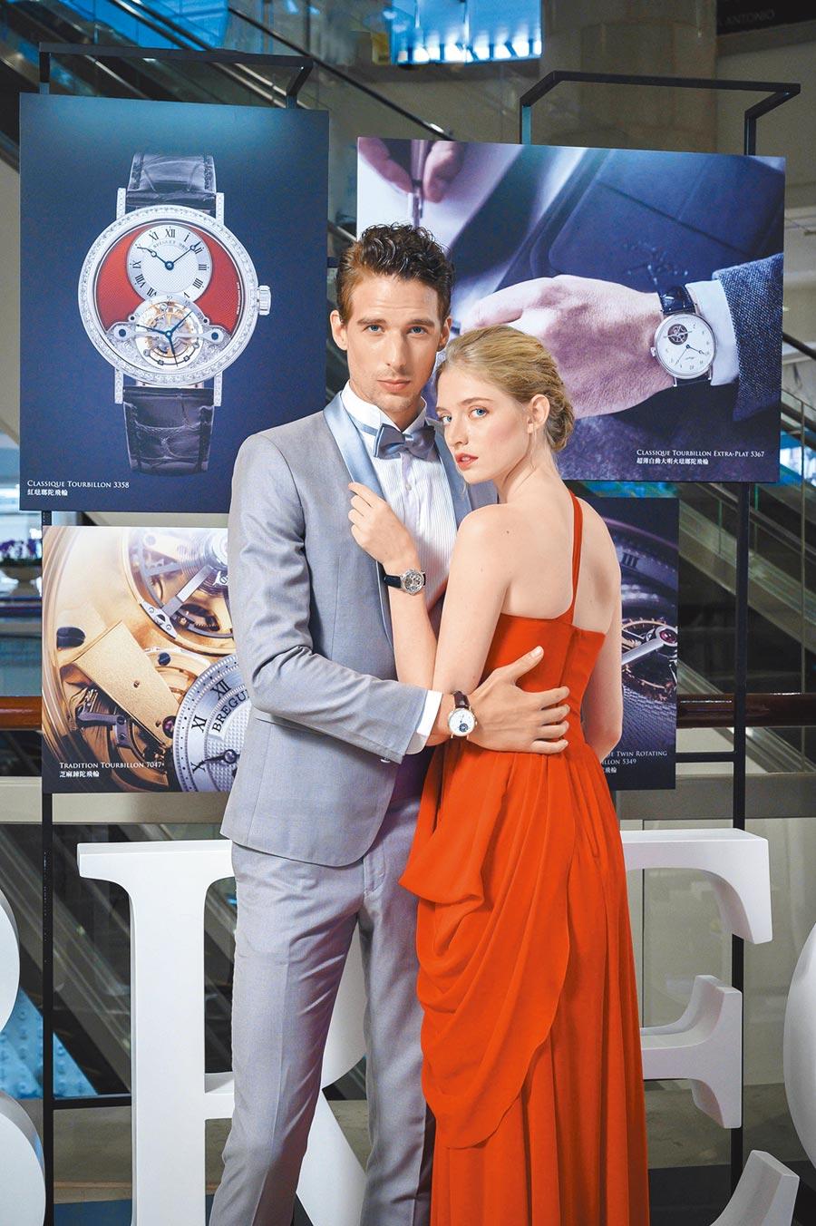 寶璣在台北101店上舉辦「陀飛輪日」歡慶活動,男模佩戴5367超薄陀飛輪表,女模佩戴3355鏤空陀飛輪表。(Breguet提供)