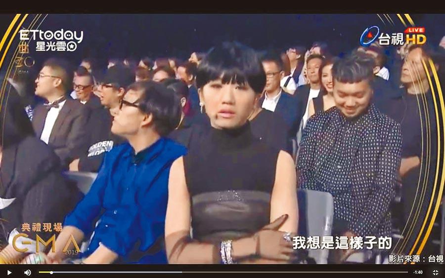 Lulu昨以短假髮造型模仿陳珊妮,十分傳神。(取材自網路)