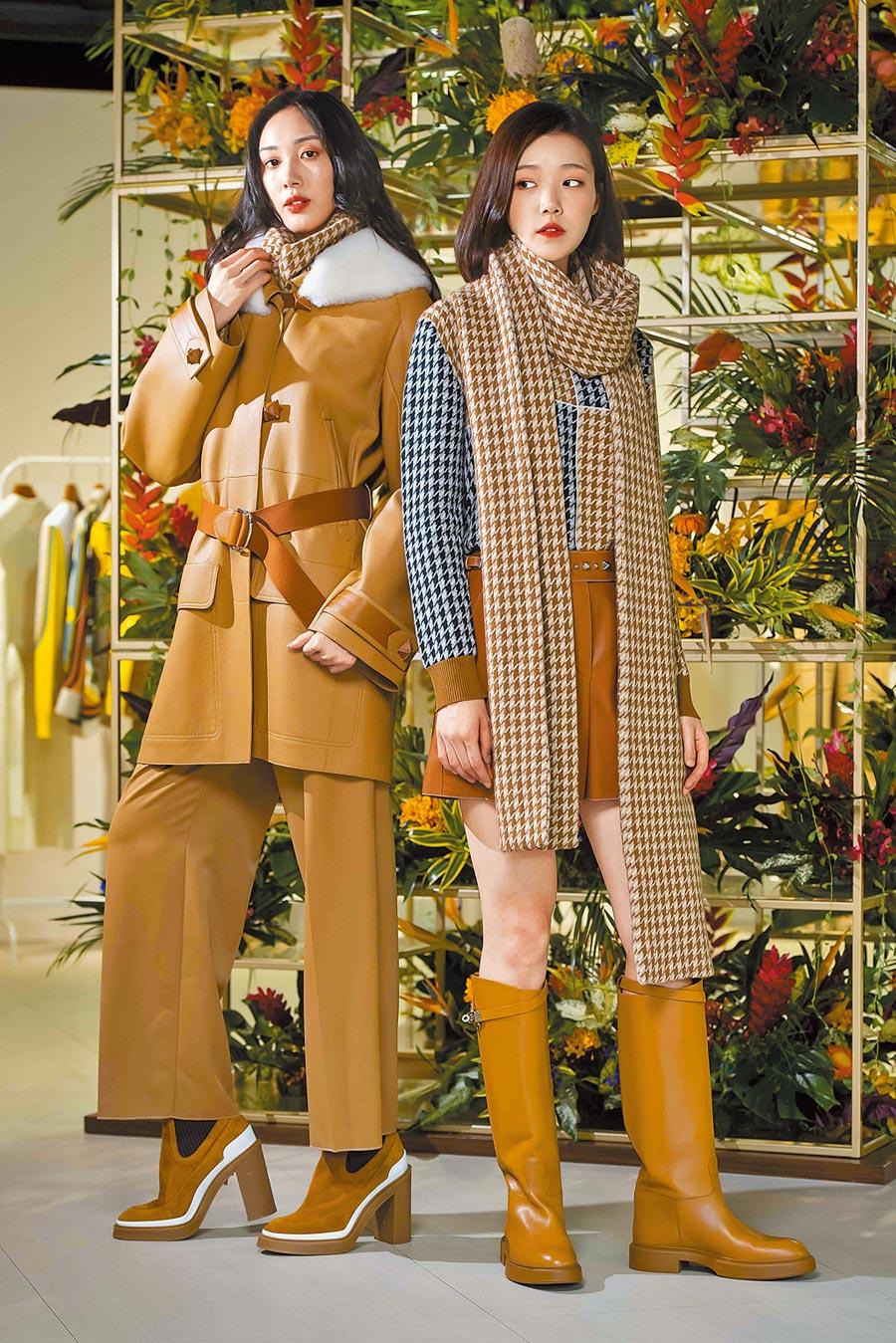 愛馬仕秋冬女裝融合新古典、新騎士風主義。左側模特兒的棕赭色可拆卸式剪羊毛皮衣領鹿皮大衣,靈感來自男士飛行員夾克,38萬8200元。棕色可拆卸式衣領喀什米爾羊絨套衫6萬6900元、棕赭色初剪羊毛高腰八分褲5萬6100元。右側模特兒的棕色蘇格蘭羊絨提花針織毛衣,參考馬術騎士服的幾何色塊,5萬1800元。棕色蘇格蘭羊絨提花針織圍巾5萬4000元,焦糖棕色小牛皮短褲17萬2600元。(HERMES提供)