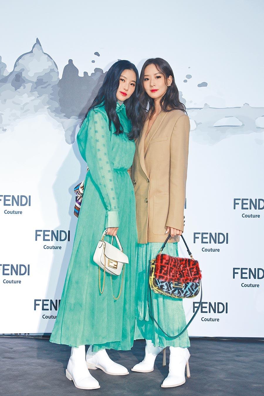 孫芸芸(右)與姊姊孫瑩瑩一起穿上綠色系裙裝,赴羅馬參加FENDI的2019秋冬高級訂製服大秀。(Fendi提供)