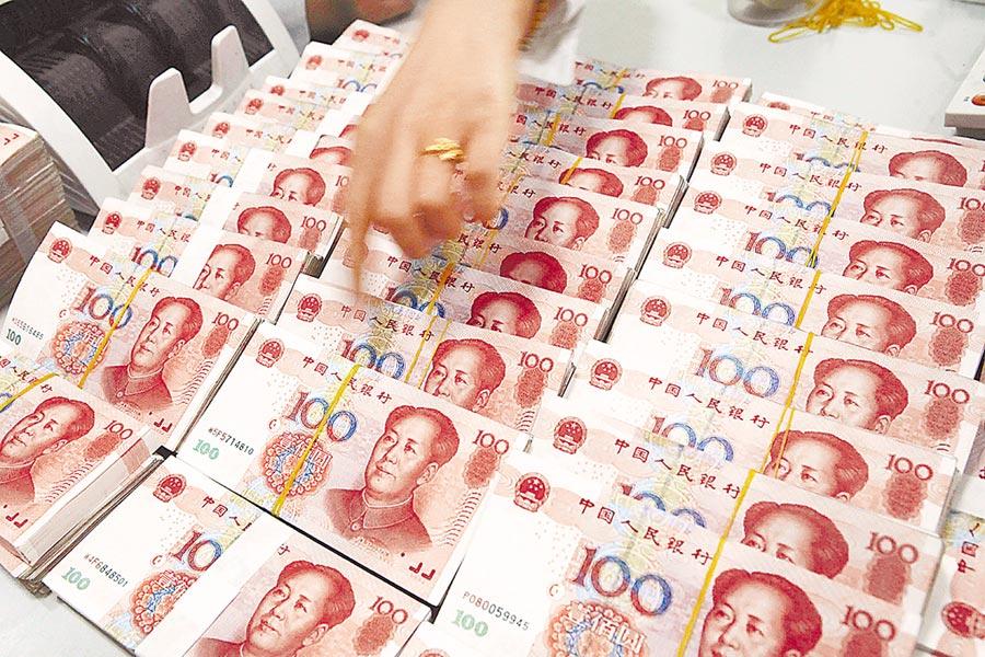 人行7天投放1.2兆人民幣,市場聞到降息的味道。(新華社資料照片)