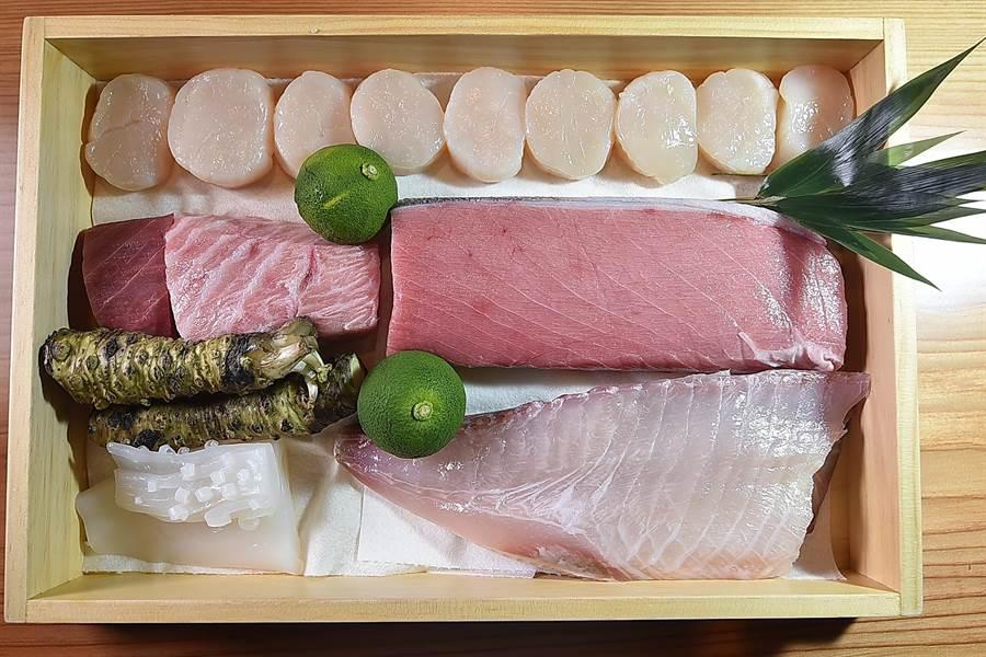 北海道大干貝、鹿兒島黑鮪魚、槍烏賊,以及鹿兒島鰝鰺,都是日本進口高檔海鮮食材。(圖/姚舜)