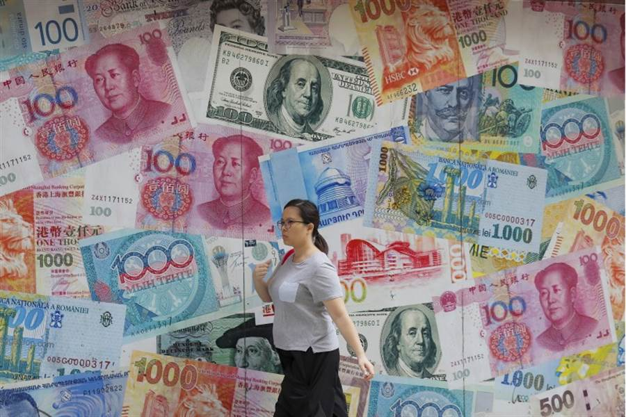 人民幣兌美元創下2008年以來的低點,一般認為,這是北京對美國向3,000億美元(近9.4兆台幣)進口陸製品加徵10%關稅的報復措施。(美聯社)