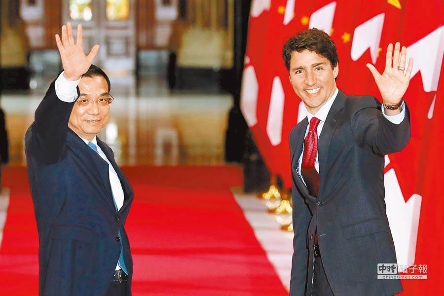 加拿大總理杜魯道(右)。(法新社)