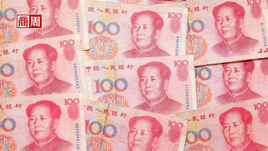 8月13日,官方正式價位的人民幣兌美元中間價報價來到7.0326的低點,創2008年3月以來新低。(來源.Dreamstime)