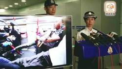 香港警方記者會:持槍投擲汽油彈者非警員