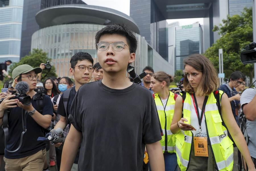 香港眾志秘書長黃之鋒將於9月3日抵台訪問。(圖/美聯社)