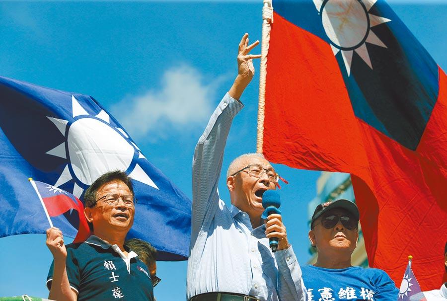 國民黨主席吳敦義再度否認換瑜消息,圖為吳敦義出席九三軍人節活動。(中央社)