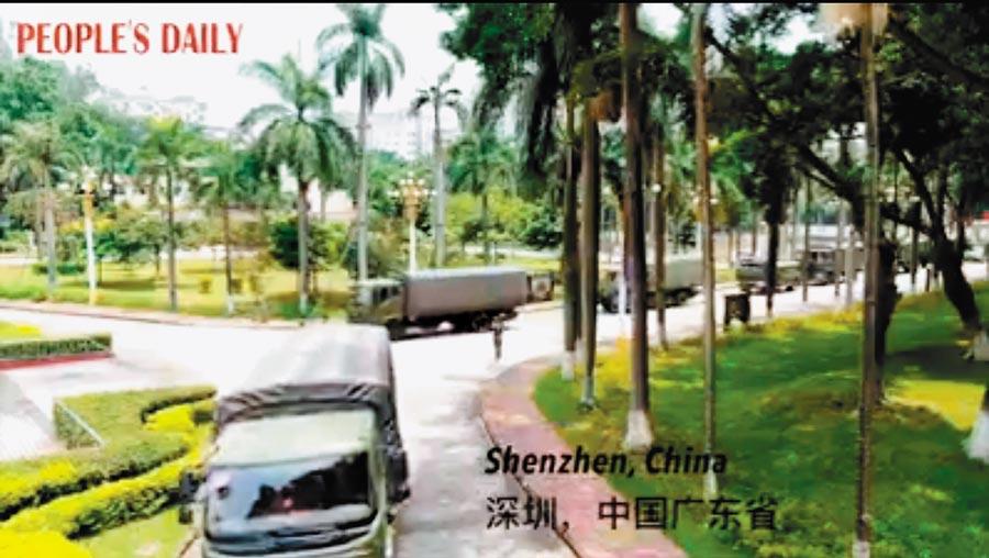 李孟居疑因拍攝解放軍在深圳集結的照片被捕。圖為解放軍正在從深圳移動到香港邊境。(取自人民日報)