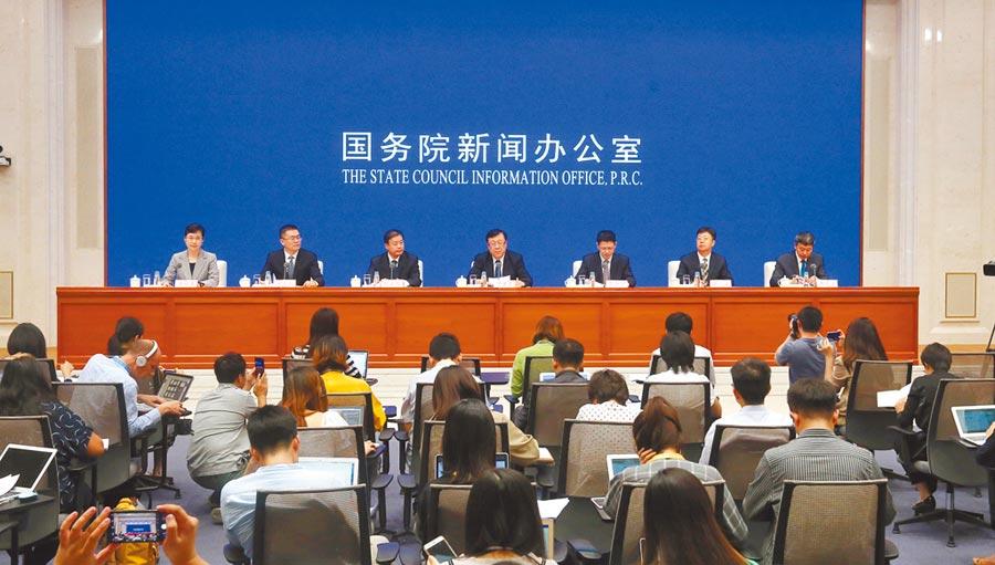 大陸國務院新聞辦公室11日針對穩定生豬生產、保障市場供應舉行新聞發布會。(新華社)