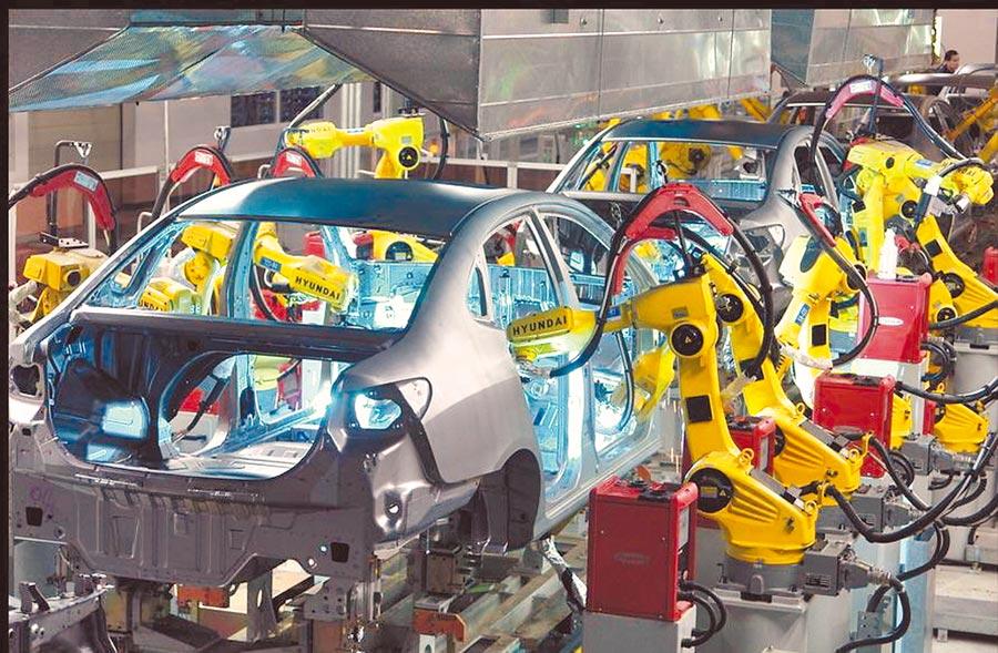 韓國現代汽車將全面收購四川現代,100%持股入主。創大陸外企獨資首例。圖為韓國現代汽車蔚山廠生產線。(現代汽車提供)
