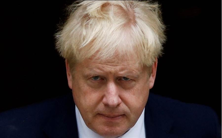 英國首相強森先前一直非常堅持,絕不會讓英國延期脫歐,4日就有文件顯示,強森已經改口告訴法庭,如果他未能與歐盟談成新協議,將要求延遲脫歐。(路透)